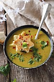 Red lentil soup with turmeric, mint, and toasted bread stars