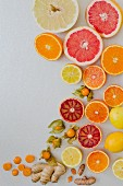 Various citrus fruits on a white background (seen from above)