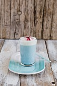 A smurf latte in a glass