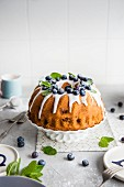 Sponge cake with blueberries and icing