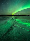 Aurora borealis over a frozen river