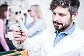 Optometrist holding lens