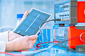 Scientist with solar fuel cell in laboratory