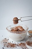 Sifting cocoa powder into a chocolate meringue mixture