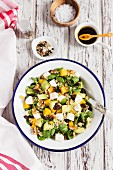 Quinoa salad with avocado, mango and lambs lettuce