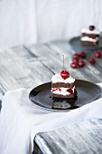 A cherry brownie with whipped cream
