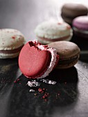 French macarons, with a bite taken out of one