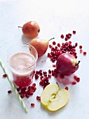 Apple and pear juice with pomegranate seeds