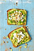 Wholemeal bread with broad bean spread, asparagus, peas and feta