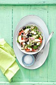 Courgette and strawberry salad with feta and black olives
