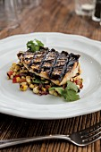 Sea bass with charred corn, onion and tomato salad
