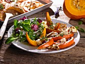 Oven-baked pumpkin wedges with feta and a side salad