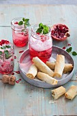 Pomegranate spritz served with feta rolls in flaky pastry