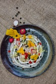 Colourful salad with radishes and courgette flowers