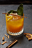 An orange drink with cinnamon