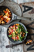 Warm chickpea salad with chicken breast and harissa