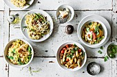 Colourful pasta dishes (spaghetti with asparagus, citrus pasta with goat's cheese, Oriental style pasta with harissa, and pastasotto with salmon and sugar snap peas)
