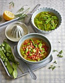 Green bean soup two ways: with dried tomatoes and bacon and with sugar snap peas and capers