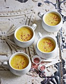 Yellow pepper soup with pink flower salt