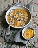 Clear mushroom soup with parmesan crisps