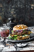 A burger with venison, mushrooms, and wild garlic paste