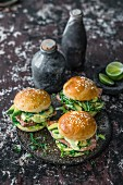 Sandwiches with sesame coated tuna, cucumber, avocado, wasabi mayo, and algae salad