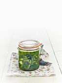 Lacto fermented green peppers in a jar