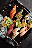 A sushi platter with cucumbers