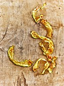 Fried courgette strips on a wooden background