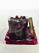 Lacto fermented olives with sage in a mason jar