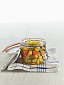 Lacto fermented mini peppers with tarragon in a mason jar