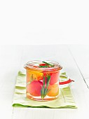 Lacto fermented tomatoes with rosemary in a mason jar