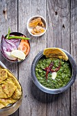 Sarson Ka Saag with Missi Roti Raw Onion Salad and Jaggery