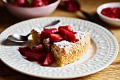 Tarta de Santiago (Spanish almond cake) with strawberry and rhubarb compote