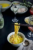 Golden Fennel Soba Noodle Soup is served with quick pickled veggies and white wine