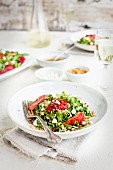 Strawberry Arugula Salad with Hibiscus Vinaigrette served with white wine