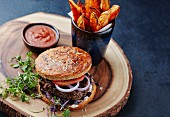 A hamburger with sweet potato fries