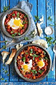 Shakshuka (poached eggs in tomato sauce) with white bread