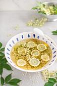 Elderflower cordial in making