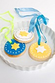 Cookies decorated with icing and star motifs, with ribbons for display