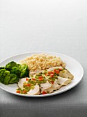 Chicken breast fillets with salsa verde, broccoli, and rice