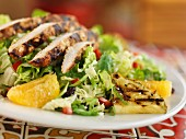 Caribbean salad with grilled chicken breast and pineapple