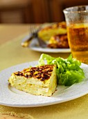 A slice of frittata with lettuce leaves