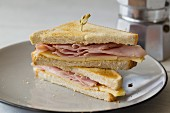 Toasted ham and cheese sandwich, halved