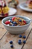 Homemade granola with fresh berries and yoghurt