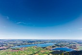 The view from the Tegelberg mountain over the Bannwaldsee and Forggensee lakes in the Allgäu region of Germany