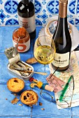 White wine, canned fish and pastel de nata (pudding tarts from Portugal)