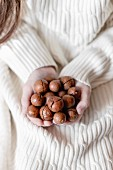 Macadamia nuts in hands