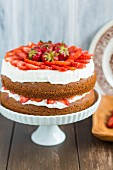 Strawberry shortcake on a cake stand