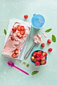 Homemade strawberry ice cream with fresh strawberries and mint